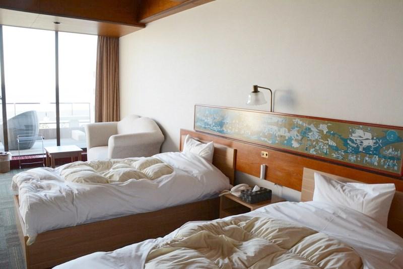 湯快リゾートホテル蘭風の和洋室のベッドの写真